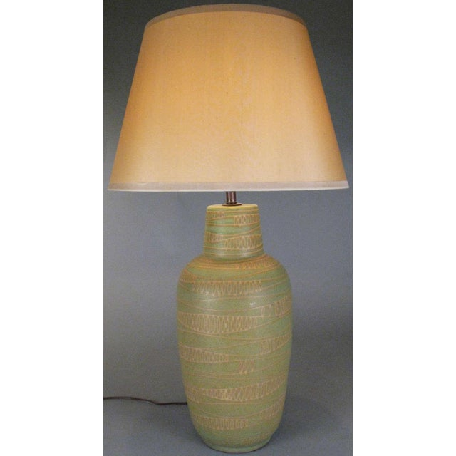 A beautiful vintage 1950 ceramic lamp by Design Technics, incised with an abstracted modulated wave pattern and finished...