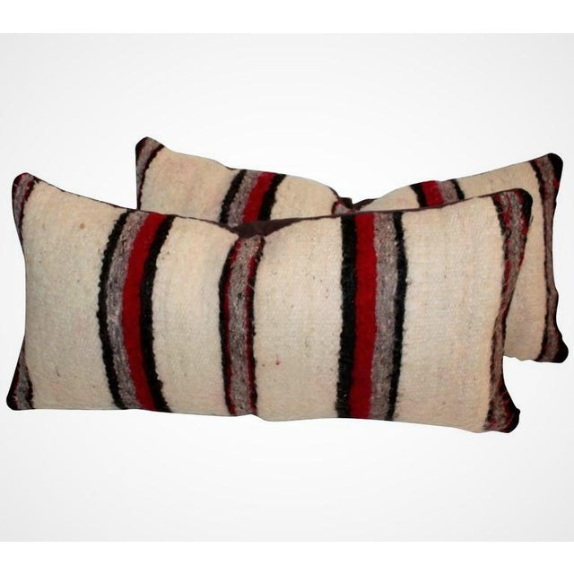 These alpaca feeling weaving bolster pillows are soft and colorful. The condition is very good. Sold as a pair.