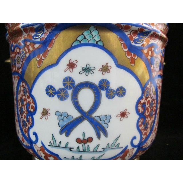 """Vintage Porcelain Imari jar or pot with light handles. Red, blue, and gold gilt design. Measures 6 1/4"""" x 6 5/8""""...."""
