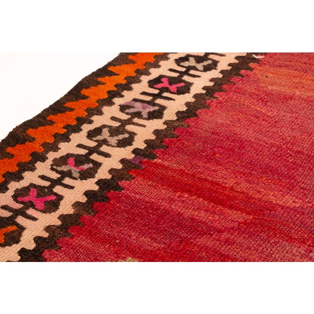 This is a traditional kilim that is brilliant in array of colors and delightful design. Make a statement with this...
