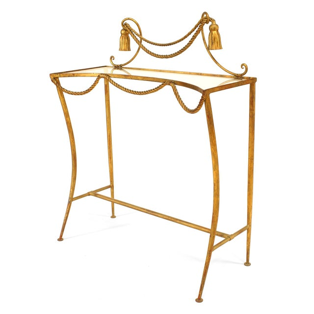 French Art Moderne (1940s) rope and tassel gilt iron freestanding console with glass top and stretcher base.