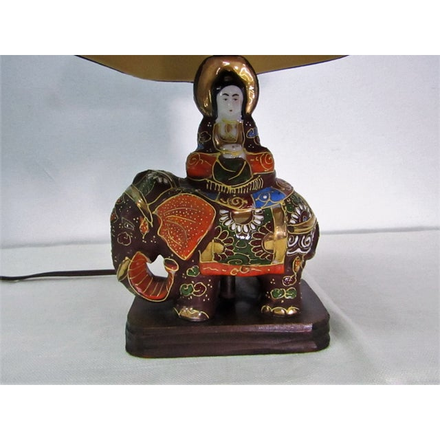 Enameled Satsuma Moriage Elephant Table Lamp with Original Shaped Bell shade in Black. The lamp is vintage with brass...