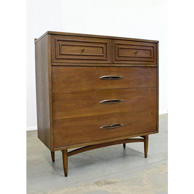 Offered is a walnut tall chest of drawers made for Broyhill Premier's 'Sculptra' line. Has 5 drawers - two small atop with...