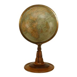 American Victorian (circa 1880) globe of the world with a brass meridian and raised on a turned wood pedestal and round base (BAKER, PRATT & CO)