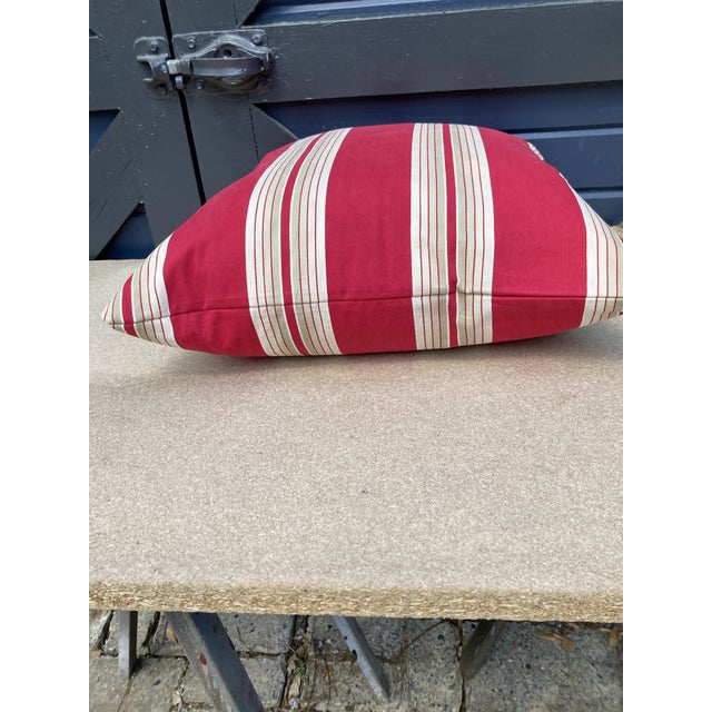 A pillow newly crafted pillow made from a circa 1900 red and white cotton stripe ticking, a down insert is included