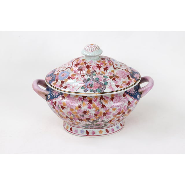 This Tureen is decorated with crowded petals and blossoms of pink, with the occasional red and yellow leaves and pring...