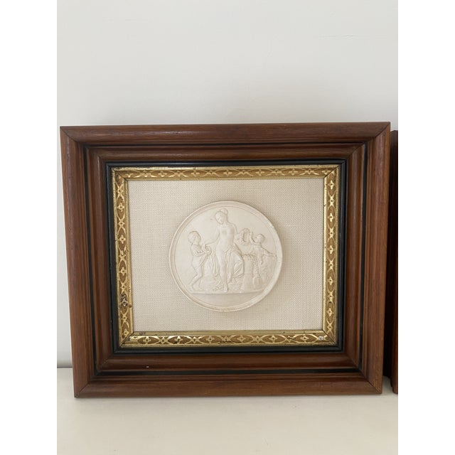 Lovely pair of mythological plaster grand tour plaques mounted on quality linen framed in exceptional antique frames.