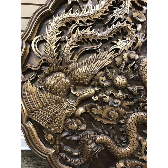 Monumental Dragon and the Phoenix wall art/medallion of a resin/fiberglass material. In good shape with out damage. Finish...