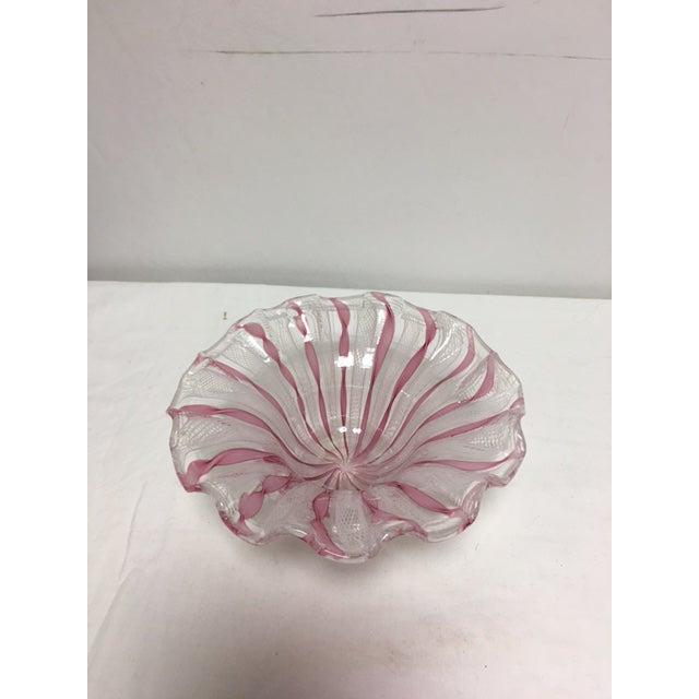 Beautiful handblown Murano glass with latticino design. It has scalloped edges. In pinks and white.