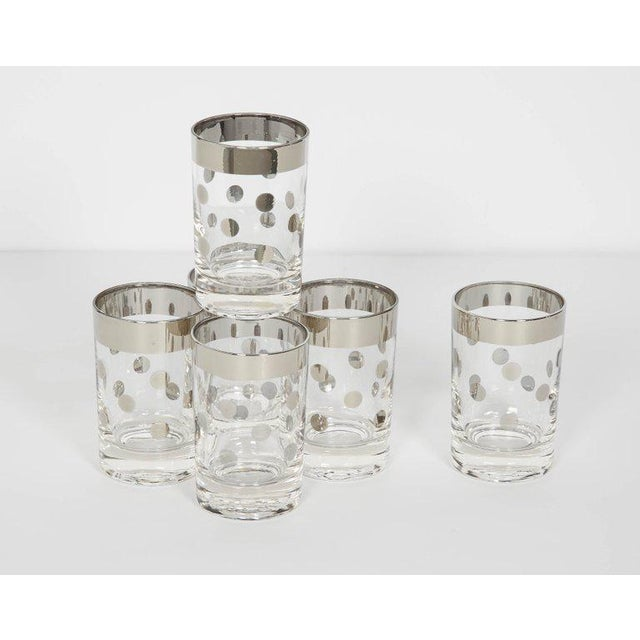 Mid-Century Modern barware glasses consisting of six perfect cylinder small cordial glasses or liqueur glasses. The...
