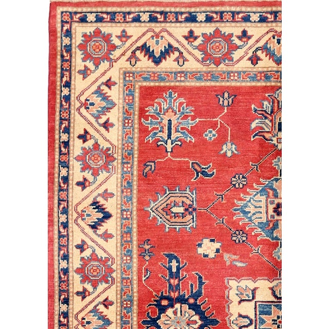 Kazak rugs are famed for their rich colors, assertive and geometric drawings, and bold, large-scale designs. The lustrous...