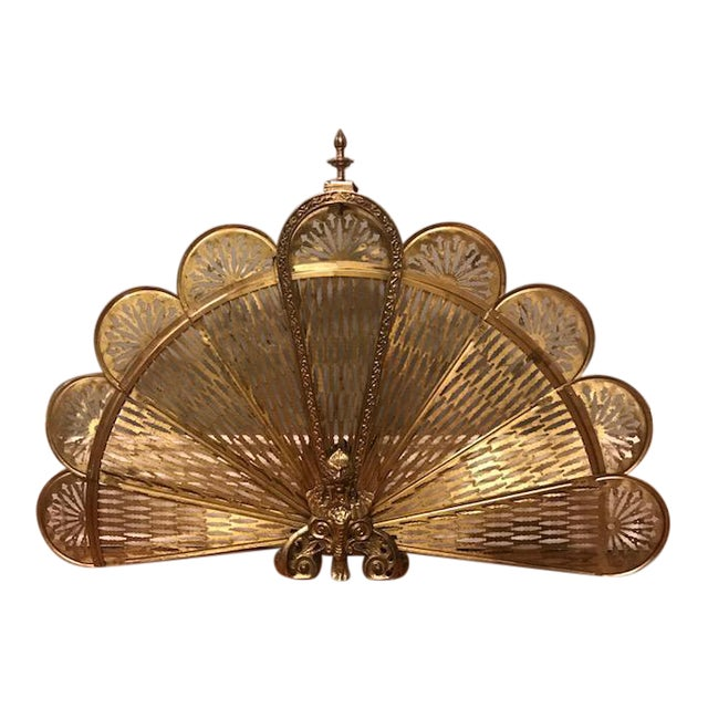 The fan segments on this majestic brass peacock fireplace screen fan out to cover an empty fireplace when it is not in use. The segments fold inwar...
