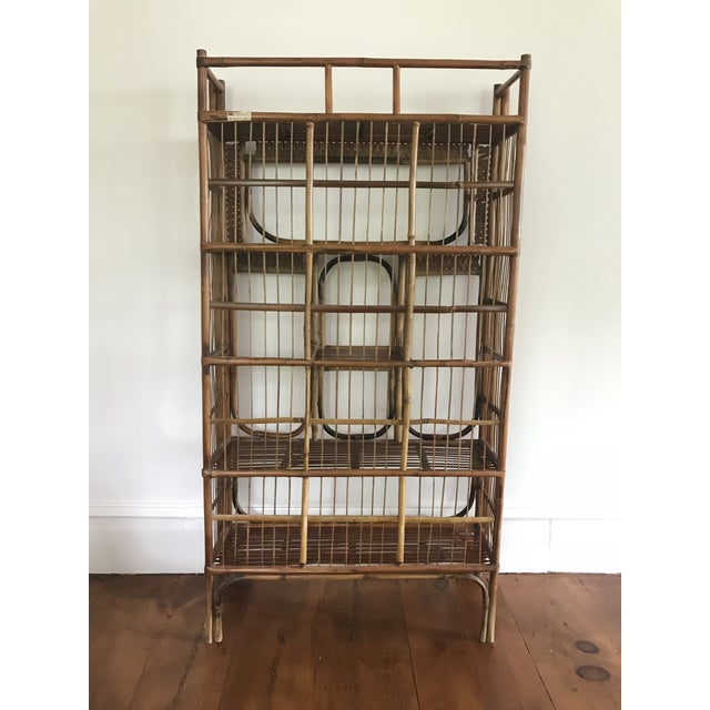 Beautiful vintage bamboo étagère bookshelf with a wonderful scale. Originally from Vietnam and brought over to the US in...