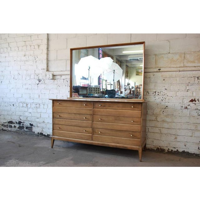 A beautiful vintage six-drawer Mid-Century Modern dresser with mirror from the Cadence line by Heywood Wakefield. The...