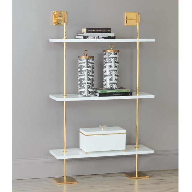 Port 68 Modern multi-tier shelf in plated gold hardware and white lacquer shelves, details urban simplicity with glam...