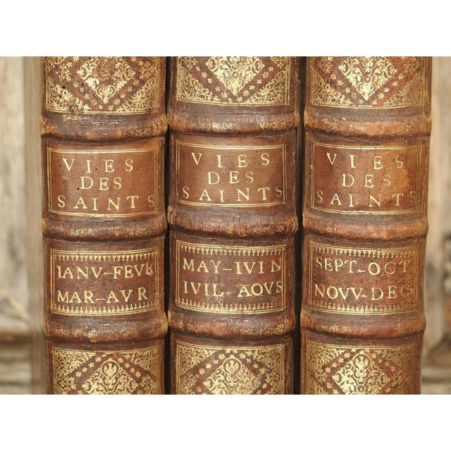 Brown Set of 18th Century French Leather Bound Books, Les Vies Des Saints, 1715 For Sale - Image 8 of 13
