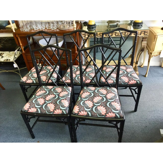 Beautifully finished set of black Chinese Chippendale style chairs. Freshly painted with black paint and newly upholstered...