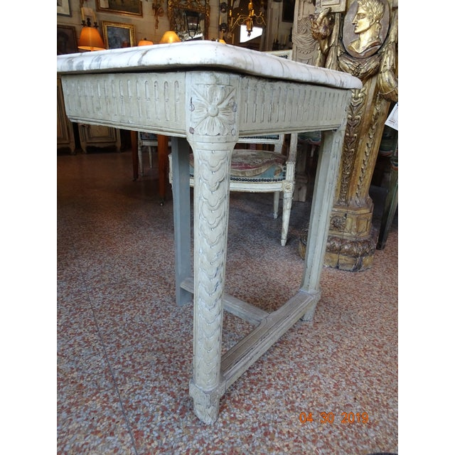 Pair of 19th century French wood consoles painted in a very pale gray/green with a one inch white and grey molded marble...