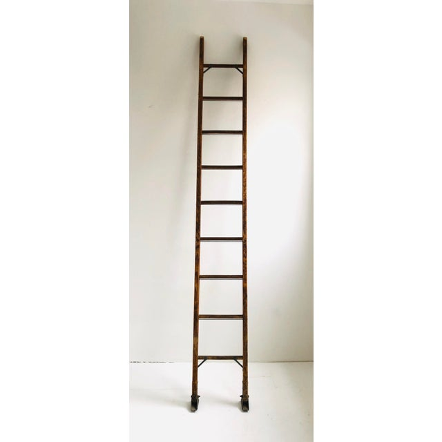 Vintage 10 foot work mans ladder with amazing details. Fully functioning and structurally strong. Feet have intact rubber...