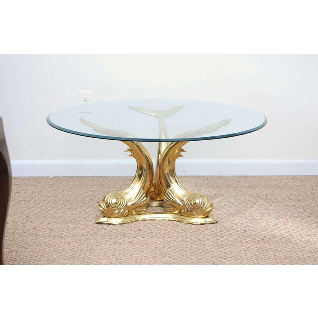 Solid cast brass coffee table that makes a glamorous statement. Beveled glass top. Note: Lead-time 2-3 weeks. Glass Top...