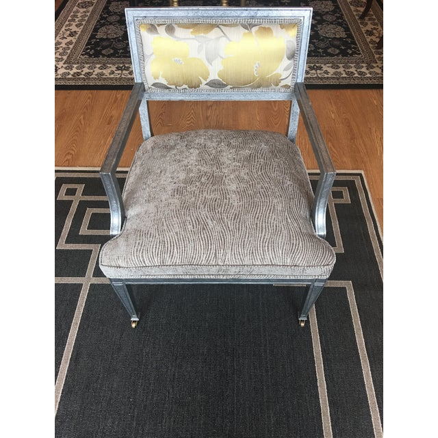 Transitional take on a Classic accent Chair In Custom Finish & Upholstery with recessed stumps and casters on front legs...