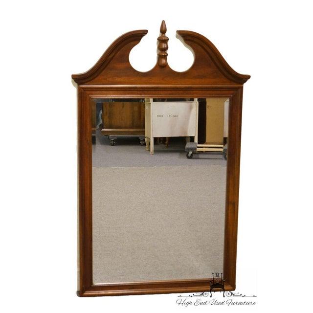Crescent solid cherry pediment top dresser/wall mirror.