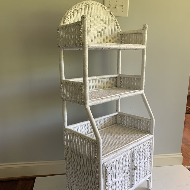 White woven wicker shelving unit with covered door storage has charm galore. Boho chic, shabby chic, and all around...