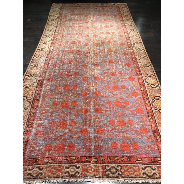 Wonderful antique Kotan rug with reds, blues, and tans.