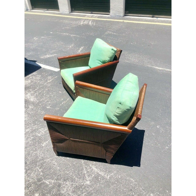 A stunning pair of lounge chairs from the limited production Merbau Collection designed by John Hutton (1947-2006) for...