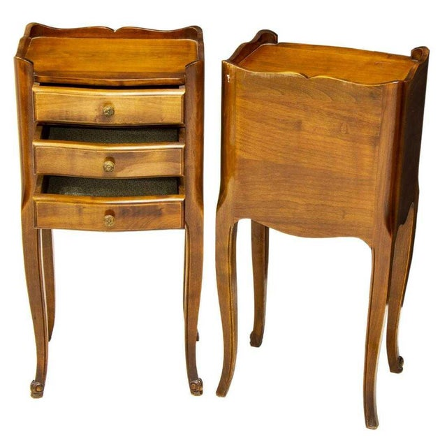 Pair of French Louis XV style walnut bedside cabinets. Made in the early 20th century. Raised gallery over shaped top,...