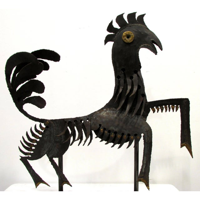 Torch cut metal sculpture of a rooster goat mix mythical figure with bronze brazed accents from Haiti mounted on new metal...