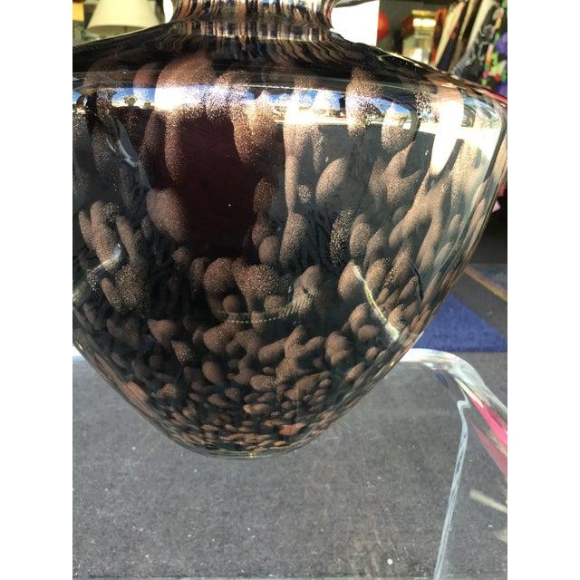 A beautiful dark purple glass (almost black) with metallic cooper dust Italian glass vase. Signed Maestri Vetrai.