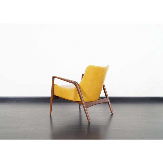 Stunning pair of Danish leather lounge chairs designed by Ib Kofod Larsen for Selig. The way the leather shell seat seems...
