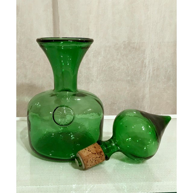 Stunning Vintage Emerald Green Italian Empoli Decanter With Fleur De Lis Accent. The unique stopper is a work of art in...