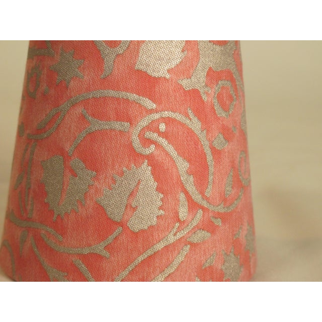 A clip top chandelier shade handmade with Fortuny fabric.
