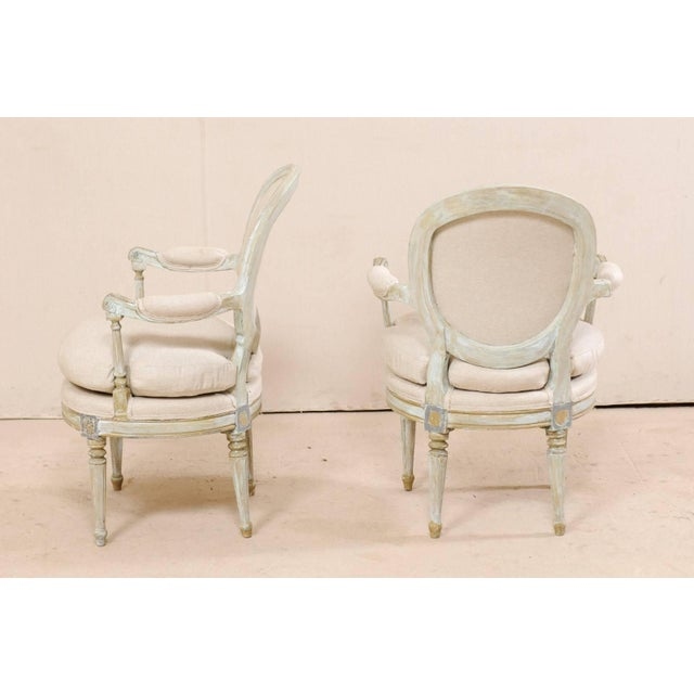 Pair of French Oval-Back Bergère Chairs With Delicately Carved Floral Motifs For Sale - Image 9 of 11