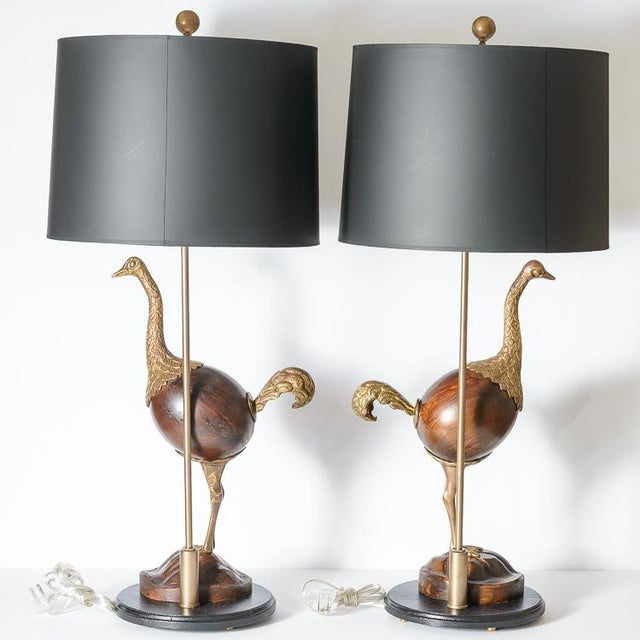 Fabulous and rare Hollywood Regency pair of Ostrich table lamps. The ostriches are made of Bronze with a wood body. This...