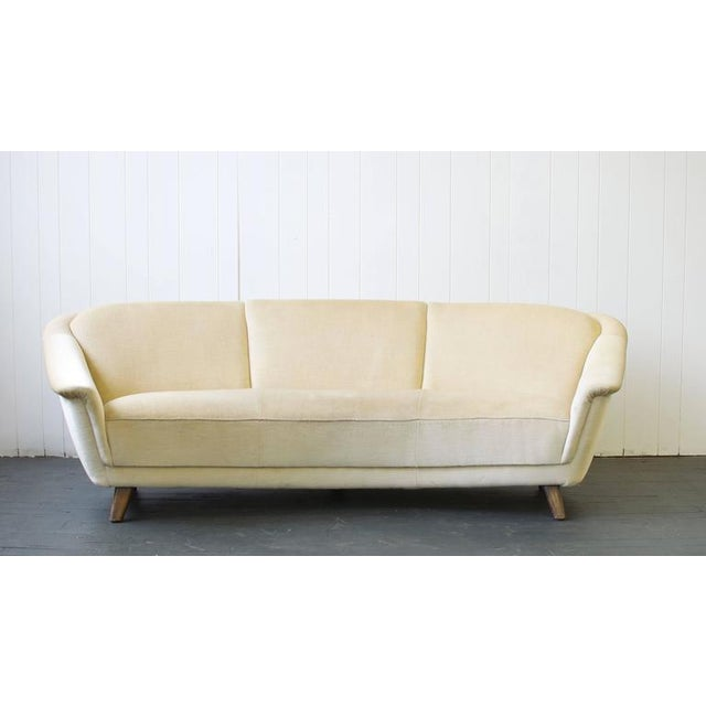 1950s curved German sofa. Matching pair chairs available. Dimensions below are for the full space with the curve. Email...