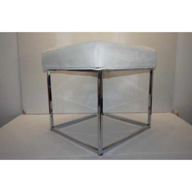 Mid century cube chrome ottoman, by Milo Baughman for Design Institute of America. In vintage upholstery, ready for...