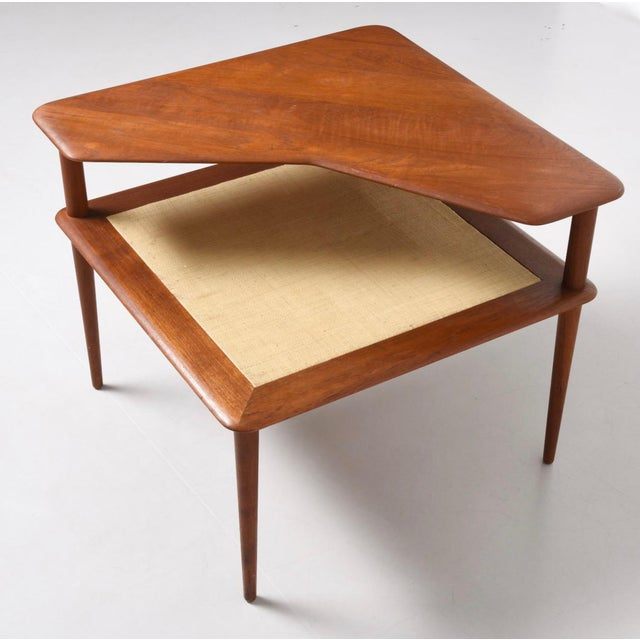 Vintage danish modern minerva teak cane corner table by peter here is a collectible low two tier corner table designed by the minerva seating watchthetrailerfo