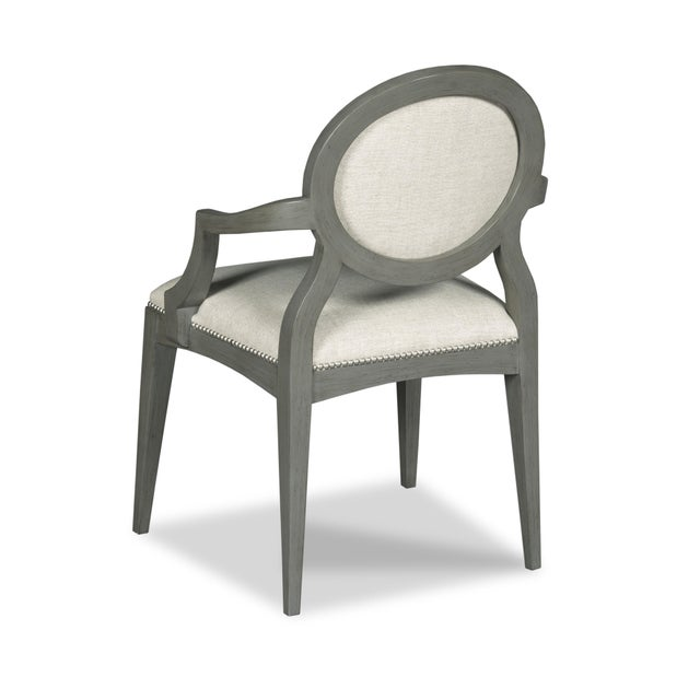 A classic design with graceful tapered legs that are joined by rails that hold an upholstered seat and oval back....