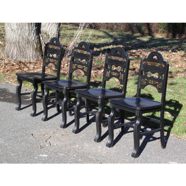Vintage Set of 4 Art Deco Black Painted Amish Folk Art Style Dining Chairs features solid wood construction, curvaceous...