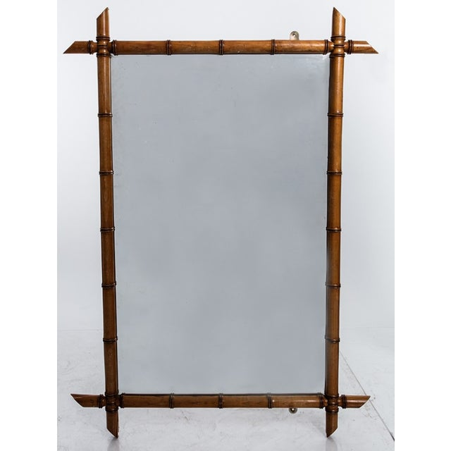 Large faux bamboo mirror reflecting the popular chinoiserie style of the 1890s.