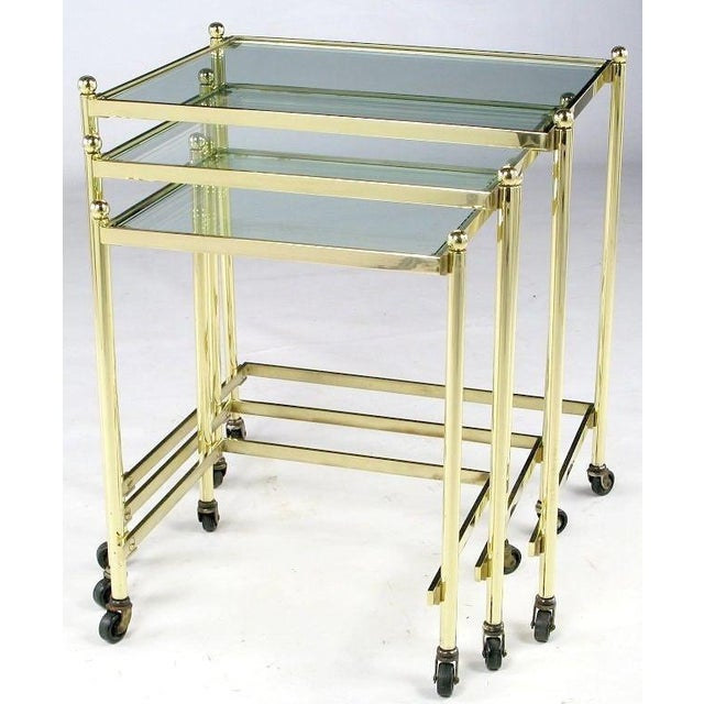An extremely well-crafted set of three nesting tables in solid brass. The workmanship is on par with that of Maison...