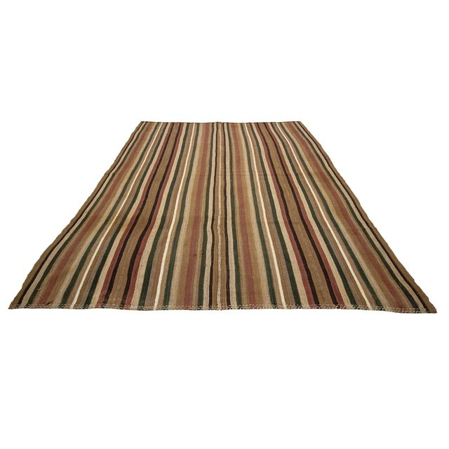 Large striped vintage kilim rug from Kars region of Turkey. Approximately 50-60 years old. In ery good condition