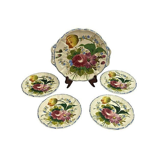 Italian handmade and hand-painted cake plate and four dessert plates. Marked on undersides. One plate has been repaired,...