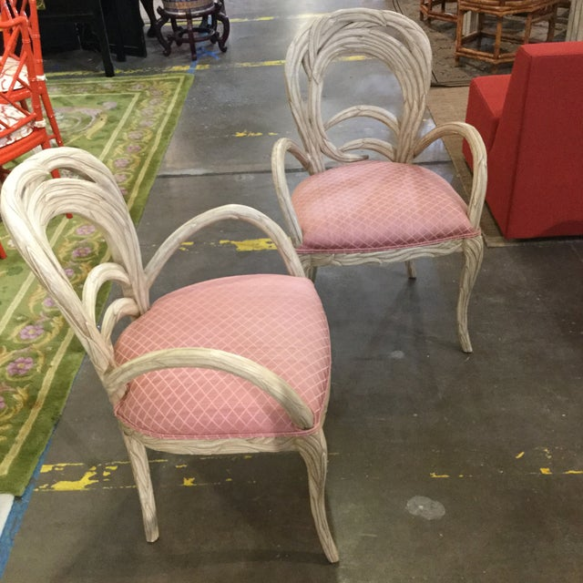 Vintage pair of Italian carved occasional chairs. Pickle finish frame and pink upholstry. Great pull up chairs.