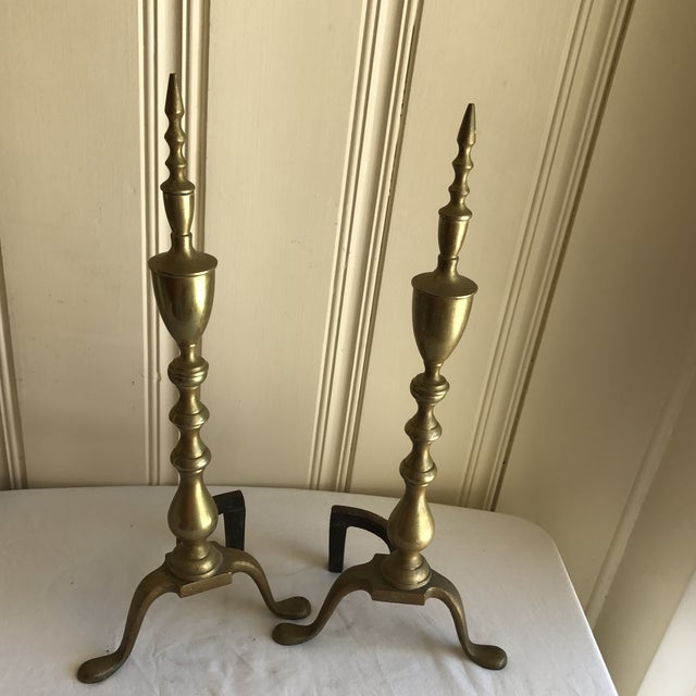 Classic Mid-Century brass andirons for the fireplace. Elegant and simple with groovy detailing. The perfect accent to...
