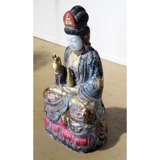 Figural Oriental distressed painted marble statue.