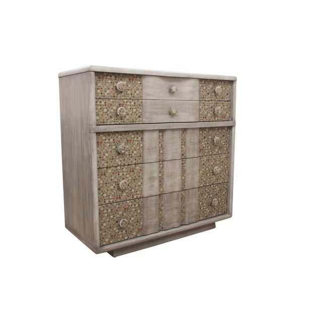 A midcentury dresser made by Kent Coffey. Five dovetailed drawers with serpentine drawer fronts are decorated with...